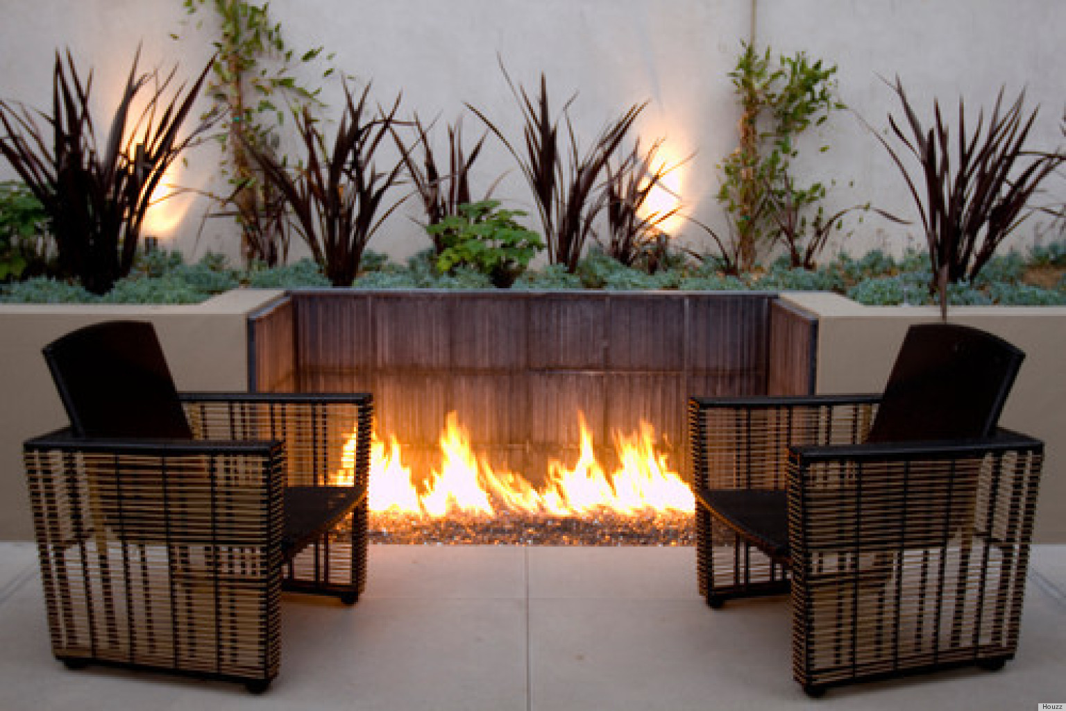 in ground fire pit design juggles cold outdoor into a warm space