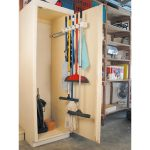stunning beige wooden broom closet design with hooks and mop and brooms aside open wooden storage