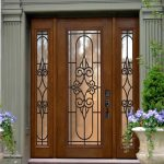 stunning brown front door design with scrolled metal trellis and frosted glass accent with triple folded style beneath grey wall