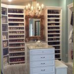 stunning custom closets nyc with wood material for wardrobe shoes and bag storages plus chest drawer and mirror and chandelier plus wood floor