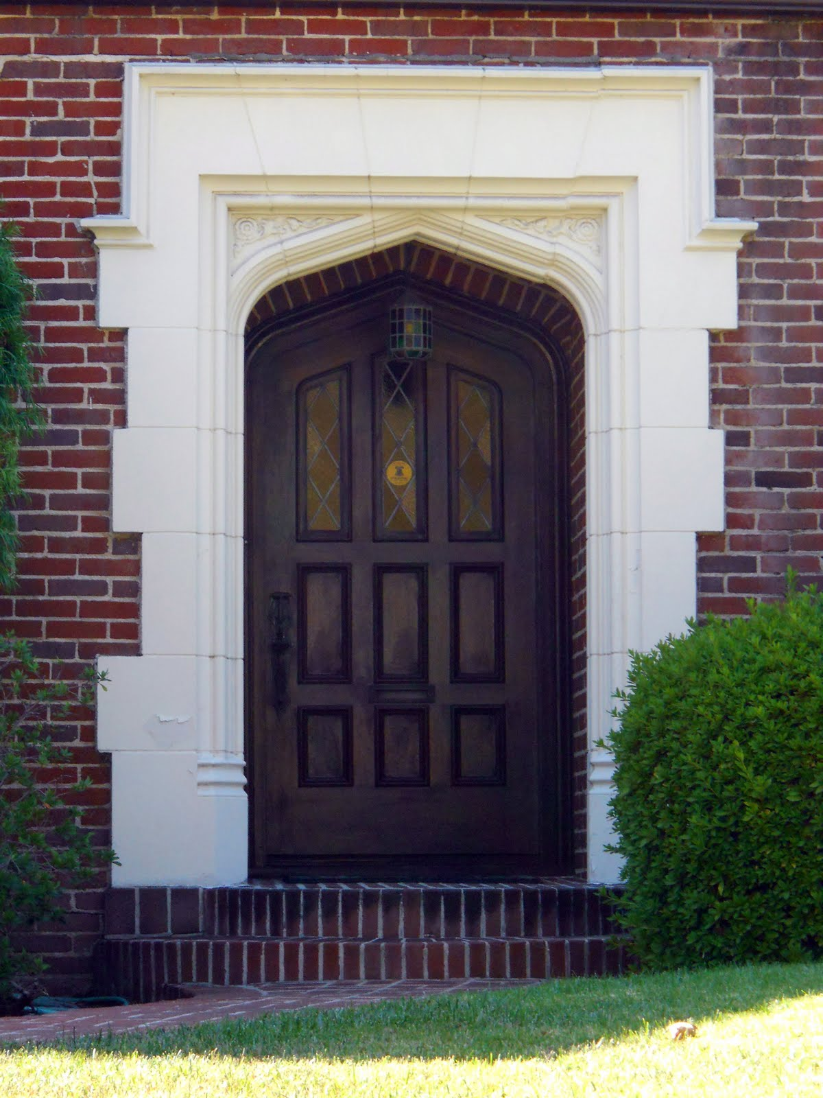 Stunning Front Door Design With Wood Panel And Elegant Frame Combined With  Lantern Lamp And Brick