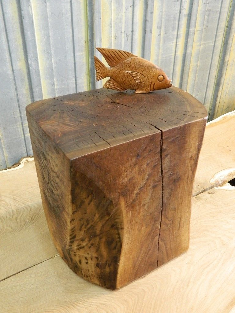 Natural Tree Stump Side Table Brings Nature Fragment into  : stunning rectangle natural tree stumps side table design with fish decoration on the countertop from homesfeed.com size 768 x 1024 jpeg 127kB
