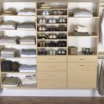 stylish custom closets nyc with wardrobe blanket shoes hat storage on white wall and wood floor