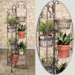 stylish indoor plant shelves design with scrolled metal frame with pot slots in multilevel design with various pots and greenery