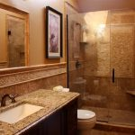 Stylish Small Bathroom Remodeling With Glass Door And Shower  Combined With Bathroom Vanity With Marble Countertop And Sink Plus Mirror And Candle Holders On Wall