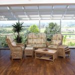 sunroom furniture in rattan material with mattress feature  hardwood floor for sunroom large glass windows with metal frames