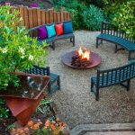 sweet outdoor living space design with green bench ann colorful cushions with round in ground fire pit idea upon coral with greenery surrounding