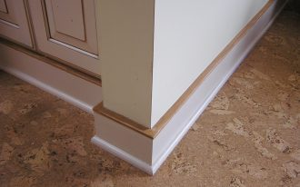 three layers of baseboards in different size of width