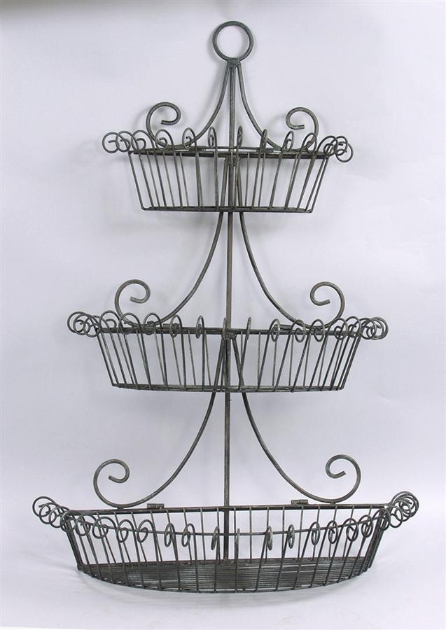 Three Layers Of Black Metal Wire Fruits Basket Mounted On The Wall