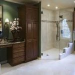 traditional accessible bathroom idea with wooden closet and ethnich vanity beenath simple wall mirror above white flooring idea aside corner transparant shower design
