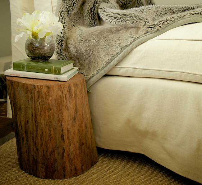 Tree Stump Side Table In Bedroom With Two Books And A Glass Pot Plus Vivid  Flower