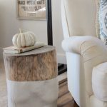 trunk stump side table with half way white paint a comfy reading chair in white wood planks floors