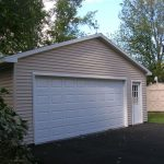 two car garage door in simple design white solid wood panel and decorative wall