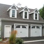 two car garage door in white solid wood material plus cool door panel plus window on top and wall scones