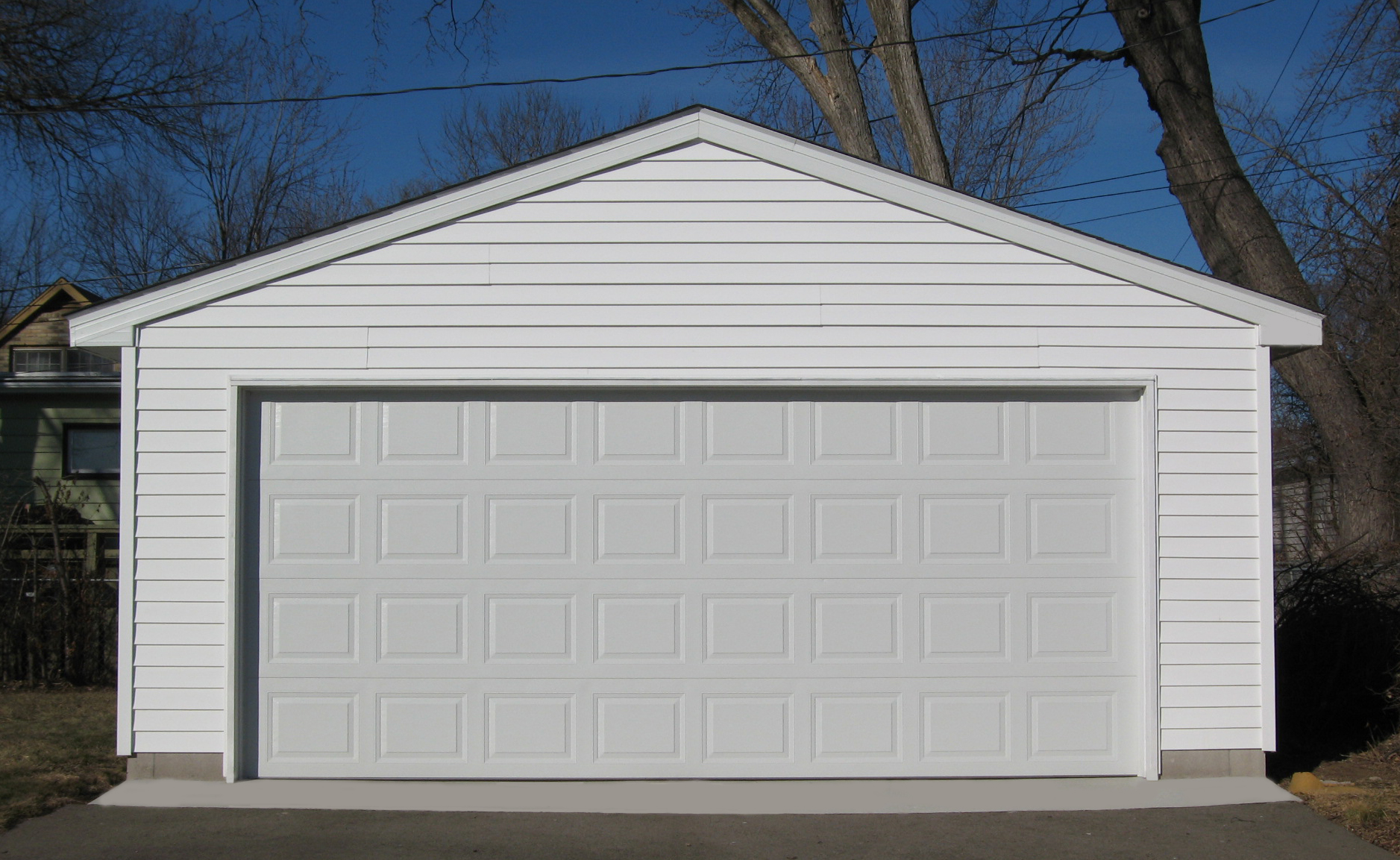 Awesome two car garage doors that will inspire you homesfeed for How big is a two car garage
