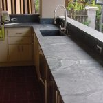unfinished soapstone surface for kitchen  counter with deep square sink and faucet