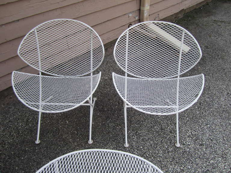 Unique And Funky Lawn Chairs In White Color And In White Metal Wire Material