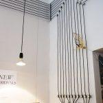 unique black electrical cable arrangement on wall