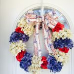 unique fourth of july wreath design made of crysantium cloth flower in blue white red colors with american flag ribbon decoration