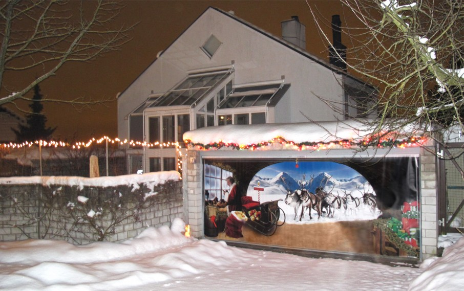 unique garage doors with christmast theme picture on door combined with christmast lighting and decoration plus brick wall and fence
