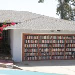 unique garage doors with library picture theme combined with gray wall