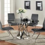 unique modern cowhide chair design in dining room with stunning round dining table with stainless steel beam and white rose before wall galleru above beige flooring style