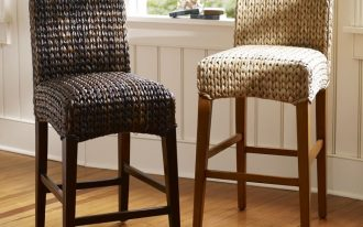 unique natural bar stool design in chair model with rattan material for seating and backrest and wooden legs with footrest