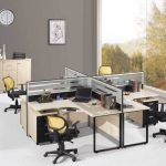 unique office design with double two sided desk design with shortpartition and beige countertop and black yellow swivel chairs and computer set with large glass window