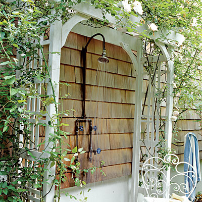 unique outdoor shower with plants as the shade wall mount shower head fixture