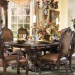 vintage luxurious dining room design with royal wooden cowhide chairs combinationn before carved wooden dining table upon cream patterned modern area rug aside glass storage and antique vanity