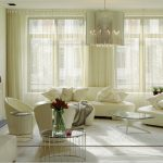 warm window treatments houston in living room with shade curtain combined with modern white sofa and glass top coffee table armchair and end table plus soft rug and chandelier