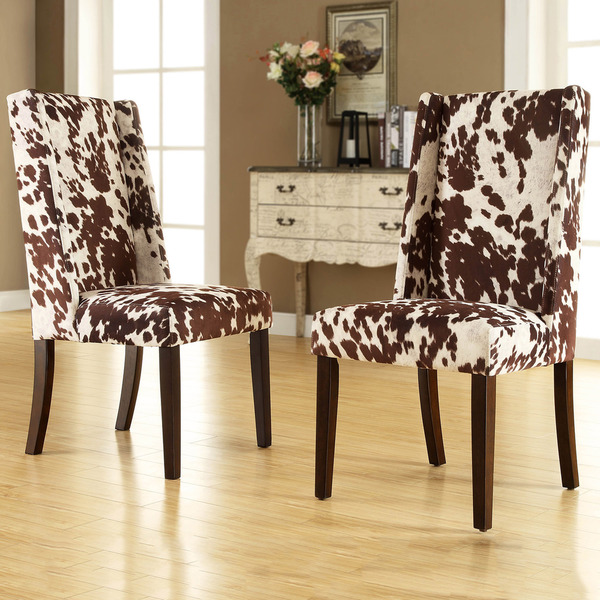 White And Black Patterns Cowhide Chairs With Dark Stained Wood Legs A  Classic Console Table With