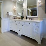 white semi modern bathroom vanity with double sinks and double black metal faucets double square mirrors with white frames and vanity lighting fixtures
