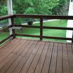 wide-black finished wood deck rails with darker finished wood floor for deck