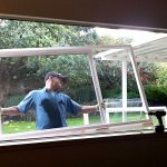 window replacement installation of large glass window and wooden frames