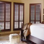 window treatments dallas brown wood shutter in modern interior bedroom