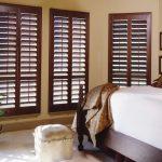 window treatments dallas brown wood shutter in modern interior bedroom