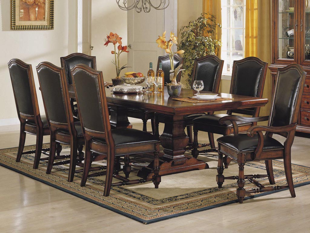 dining room design with furnished rectangle table with cowhide chairs