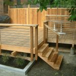 Wonderful Wooden Outdoor Terrace Design With Wooden Floor And Horizontal Metal Wooden Deck Railing With Staircase With Greenery Beneath Shady Tree