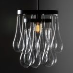 Beautiful pendant lamps with transparent glass material and black base