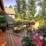 Better Homes and Gardens' landscape design for back deck a set of outdoor furniture with hanging pot for decorative plants a floral patterns carpet