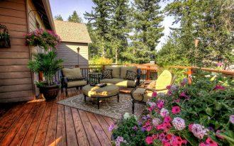 Better Homes and Gardens' landscape design for back deck a set of outdoor furniture with hanging pot for decorative plants a floral patterns carpet