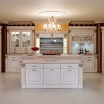 Classic kitchen design in white by Home Depot with classic crystal chandelier fixture white ceramic floor white kitchen storage systems