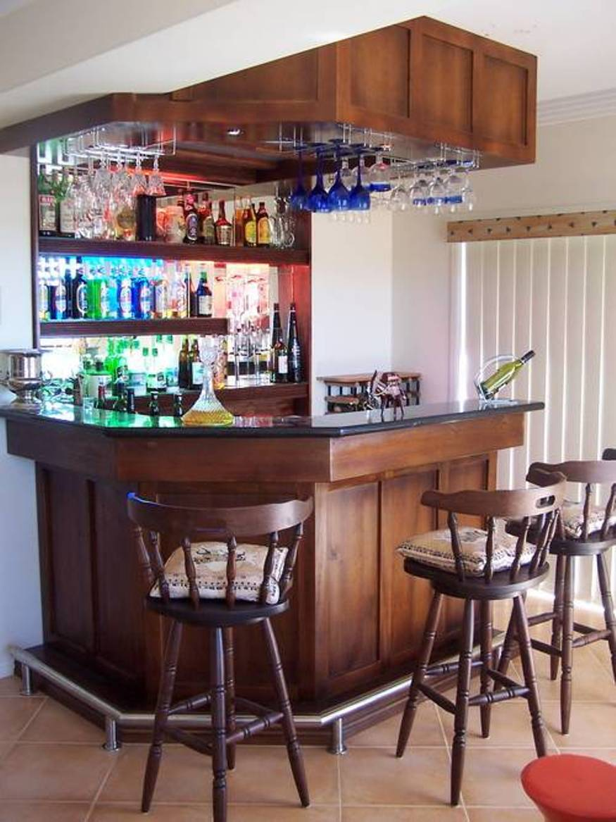 Corner Mini Wine Bar In A Home With Three Wood Barstools Plus Their  Decorative Pillows A