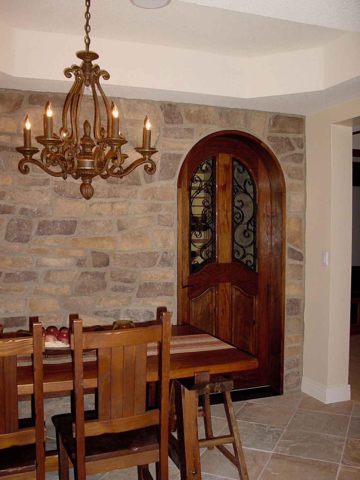Curved Interior Door Design Made From Hardwood With Darker Brown Staining  And Black Crafted Metal A
