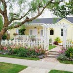 Front yard for small and simple ranch home with wood fence system