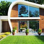 Futuristic home design for an eco friendly house with patio and simple landscape idea