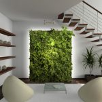 Indoor green and fresh artificial park mounted on wall floating wood panels as the shelves for decorative items a pair of  modern style chairs white wool rug low legs glass table a stair construction