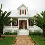 Key West tropical home design with two sides of poches outdoor stairs system crafted wood railing system in white