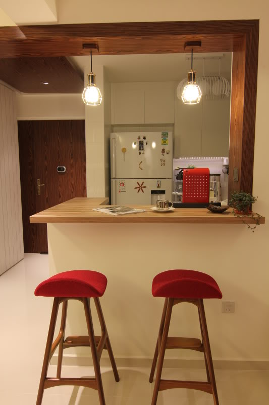 L Shape And Small Corner Kitchen Bar With A Pair Of Bar Chairs With Red  Seating